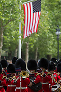 On US President Donald Trumps first day of a controversial three-day state visit to the UK by the 45th American President, a guards band marches down the Mall, beneath the US Stars and Stripes flag, on 3rd June 2019, in London England.