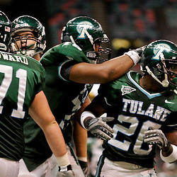 Sep 26, 2009; New Orleans, LA, USA; Tulane Green Wave wide receiver Jeremy Williams (20) is congratulated by teammates after scoring a touchdown against the McNesse State Cowboys at the Louisiana Superdome. Tulane defeated McNeese State 42-32. Mandatory Credit: Derick E. Hingle-US PRESSWIRE