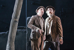 "© Licensed to London News Pictures. 05/06/2015. London, UK. L-R: Richard Roxburgh as Estragon and Hugo Weaving as Vladimir. Actors Richard Roxburgh and Hugo Weaving star in Samuel Beckett's ""Waiting for Godot"" at the Barbican Theatre. Part of the International Beckett Season, this Sydney Theatre Company play is directed by Andrew Upton. With Luke Mullins as Luke, Philip Quast as Pozzo, Richard Roxburgh as Estragon and Hugo Weaving as Vladimir. Performances from 4 to 13 June 2015 at the Barbican Theatre. Photo credit : Bettina Strenske/LNP"