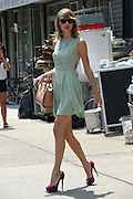 New York, New York, U.S. -  <br /> <br /> Taylor Swift Leaves New York Gym<br /> <br /> Singer TAYLOR SWIFT wearing a green polka dot sundress Ray Ban sunglasses, S necklace and carrying a purse after a gym workout in New York. <br /> ©ZP/Exclusivepix