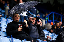 Leicester City fans shield themselves from the rain - Mandatory by-line: Robbie Stephenson/JMP - 29/09/2019 - FOOTBALL - King Power Stadium - Leicester, England - Leicester City v Newcastle United - Premier League