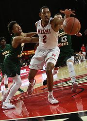November 14, 2017 - Oxford, Ohio, U.S - Miami (Oh) Redhawks forward Rod Mills Jr. (2) runs down a loose ball and keeps it away from Wright State Raiders guard Mark Hughes (3) on the play on Tue Nov 14, 2017 in Oxford,Ohio. (Credit Image: © Ernest Coleman via ZUMA Wire)
