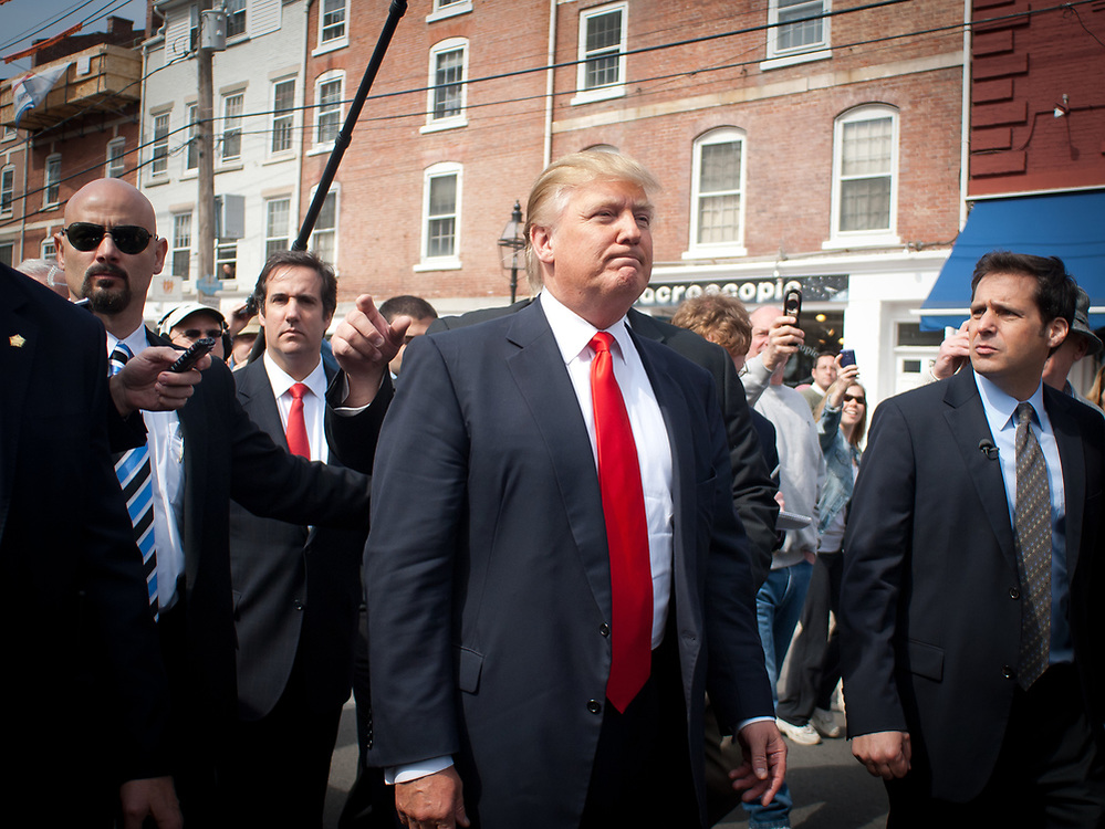Trump supporters try to catch a glimpse of Trump as he walks around Portsmouth.Real Estate Mogul, TV Star and Presidential hopeful Donald Trump makes a visit to Portsmouth, NH for meetings and a meet and greet as he walks around Downtown Portsmouth.