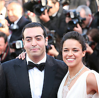 Mohammed Al Turki and Actress Michelle Rodriguez at the Killing Them Softly gala screening at the 65th Cannes Film Festival France. Tuesday 22nd May 2012 in Cannes Film Festival, France.