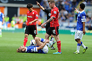 Everton's Nikica Jelavic lies injured. Barclays Premier league, Cardiff city v Everton at the Cardiff city Stadium in Cardiff,  South Wales on Saturday 31st August 2013. pic by Andrew Orchard,  Andrew Orchard sports photography,