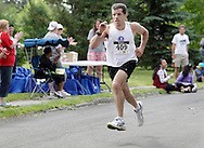 Middletown, New York - Ray Revell of Wurtsboro heads for the finish line in the 15th annual Ruthie Dino Marshall 5K Run and Fun Walk hosted by the Middletown YMCA on Sunday, June 5, 2011. He finished fourth. ©Tom Bushey / The Image Works