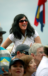 28 April 2013. New Orleans, Louisiana,  USA. .A lady in the crowd enjoys Juan Luis Guerra, legendary Latin musician playing the Congo Square stage at the New Orleans Jazz and Heritage Festival. Guerra is one of the most recognised Latin artists with 15 Latin Grammy Awards and 2 Grammy Awards to his name amongst a host of other accolades..Photo; Charlie Varley.