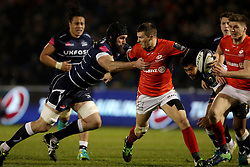 Saracens Richard Wigglesworth holds off Sale Sharks Bryn Evans (left) during the European Champions Cup, pool three mach at the AJ Bell Stadium, Salford.