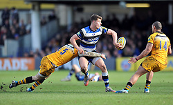 Ollie Devoto (Bath) offloads the ball after being tackld by Elliot Daly (Wasps) - Photo mandatory by-line: Patrick Khachfe/JMP - Tel: Mobile: 07966 386802 22/02/2014 - SPORT - RUGBY UNION - The Recreation Ground, Bath - Bath v London Wasps - Aviva Premiership.