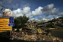 A tank sits as a monument to the victory of Hezbollah over the South Lebanon Army, SLA, during the Lebanese civil war, Blida, Lebanon,  March 10, 2005. Earlier in the week hundreds of thousands of pro-Syrian protesters answered the nationwide call from Hezbollah, the militant Shiite Muslim group, to demonstrate against foreign intervention.