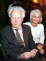 LORD MOYNE and his close friend MRS SHOE GUINNESS-TAYLOR<br />  at a party in London on 14th April 2000.OCU 24
