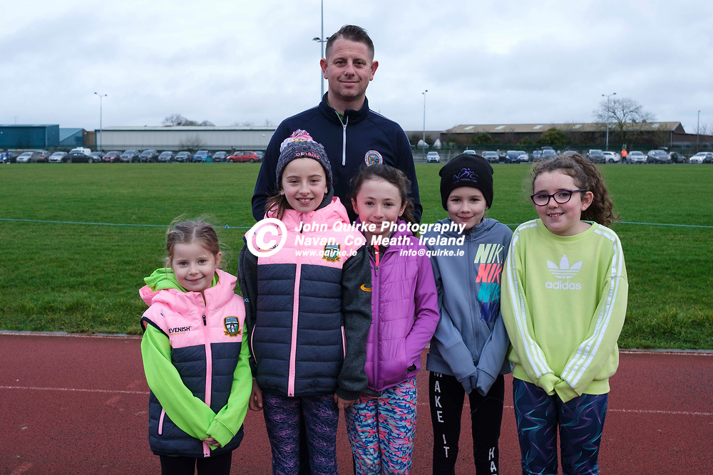 27/12/2019, Rita & Robbie Christmas 5k Road Race at Claremount Stadium<br /> Pictured at the event, L-R, Derek, Ellie and Charley Coogan with Holly O`Neill, Ellie & Aoibhann Clarke<br /> Photo: David Mullen / www.quirke.ie ©John Quirke Photography, Unit 17, Blackcastle Shopping Cte. Navan. Co. Meath. 046-9079044 / 087-2579454.<br /> ISO: 400; Shutter: 1/250; Aperture: 5.6; <br /> File Size: 6.6MB