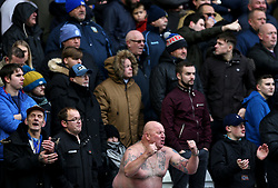 A shirtless Sheffield Wednesday fan in the stands shows his support during the match