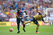 Yannick Bolasie of Crystal Palace goes past Nacho Monreal of Arsenal as he competes for the ball. Barclays Premier league match, Crystal Palace v Arsenal at  Selhurst Park in London on Sunday 16th August 2015.<br /> pic by John Patrick Fletcher, Andrew Orchard sports photography.