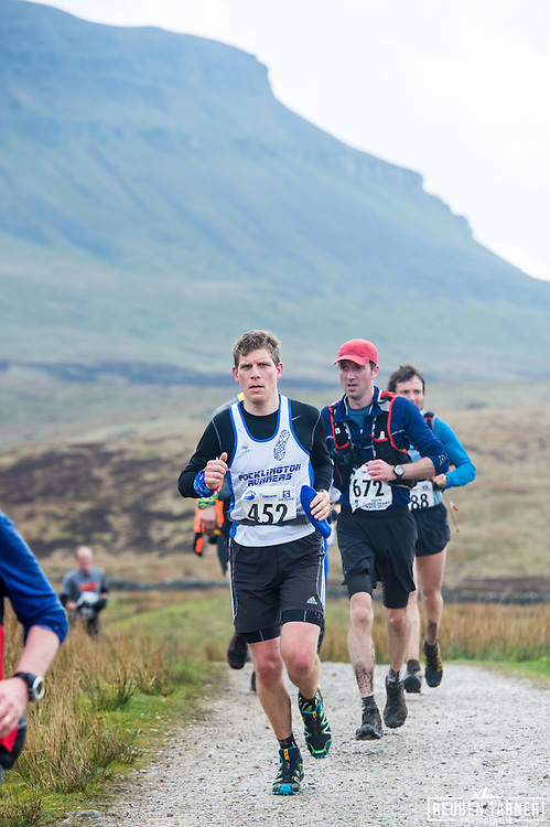 Runners makes their way back down Pen-y-ghent in the Yorkshire Dales during the 60th Yorkshire Three Peaks Race.