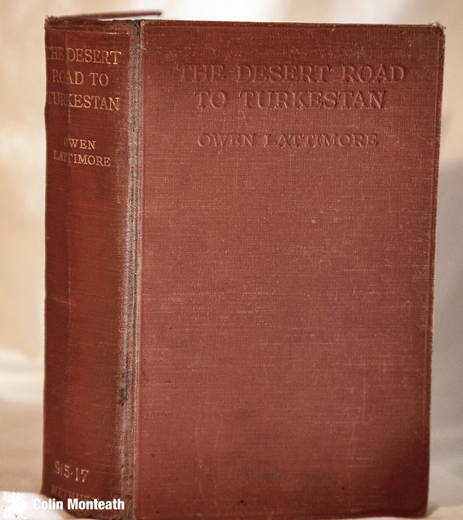 THE DESERT ROAD TO TURKESTAN - Owen Lattimore - Methuen, London, 1928, 1st UK edn., 330 pages, hardback in original brown/orange cloth, ex-lib with usual lib markings & one end paper map torn - numerous B&W plates - An exciting overland journey with camel caravans from Peking to India through desolate Mongolia and on into Central Asia. Lattimore was America's foremost expert & prolific author on China, Mongolia and Central Asia who was persecuted in USA during the McCarthy era....a scarce book in any condition .-  $NZ85.