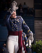 Cadet Matthew Devine, who played the role of Spike The Bulldog at The Citadel's athletic events for the 2020-2021 school year, waves to the crowd with his bulldog gloves after receiving his diploma on Saturday, May 8, 2021.<br /> <br /> Credit: Cameron Pollack / The Citadel
