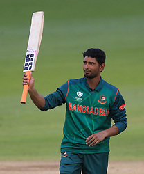 Bangladesh's Mahmudullah raises his bat after reaching his century during the ICC Champions Trophy, Group A match at Sophia Gardens, Cardiff.