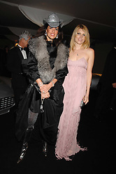 Left to right, CHRISTINA ESTRADA-JUFFALI and MEREDITH OSTROM at the London Red Cross Ball themed 'Honky Tonk Blues' held at 99 Upper Ground, London SE1 on 21st November 2007.<br />