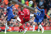 Football - 2018 / 2019 Premier League - Liverpool vs. Chelsea<br /> <br /> Fabinho of Liverpool competes with Callum Hudson Odoi and Ngolo Kante of Chelsea at Anfield.<br /> <br /> COLORSPORT/PAUL GREENWOOD