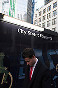 City dwellers pass beneath advice about street etiquette on a construction hoarding in the City of London, the capital's financial district, on 24th January 2019, in London, England.