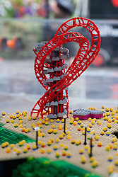 © Licensed to London News Pictures. 05/07/2012. London, UK. A minature LEGO replica of the Orbit. LEGO creator, Warren Elsmore used around 250,000 standard LEGO bricks to create a miniature replica of the London 2012 Olympic Games Park. The model took Warren, aged 35 from Edinburgh, 300 hours to construct and is on display at the 'Visit Denmark' Olympic Village  at St Katharine Docks, London. Photo credit : Vickie Flores/LNP