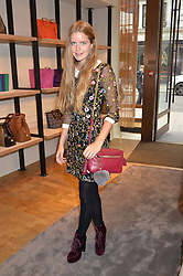 KATIE READMAN at a lunch hosted by Alice Naylor-Leyland and Tamara Beckwith in celebration of the Coach 2015 collection held at Coach, New Bond Street, London on 18th September 2014.