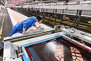 Lyon, Atelier Hermès, silk atelier at Pierre-Benite, Vanessa controlla eventuali difetti di stampa che possono essere imeediatemente corretti. Vanessa first  print check