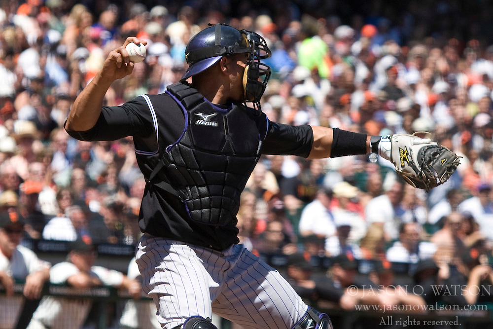 May 1, 2010; San Francisco, CA, USA;  Colorado Rockies catcher Miguel Olivo (21) checks a runner at third base during the second inning against the San Francisco Giants at AT&T Park.  San Francisco defeated Colorado 6-1.