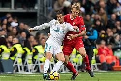 (L-R) Cristiano Ronaldo dos Santos Aveiro of Real Madrid, Simon Kjaer of Sevilla FC during the La Liga Santander match between Real Madrid CF and Sevilla FC on December 09, 2017 at the Santiago Bernabeu stadium in Madrid, Spain.