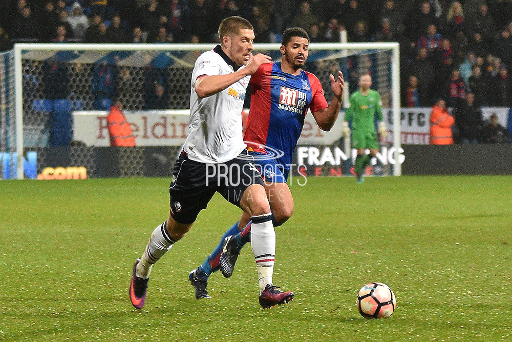 Bolton Wanderers Forward, Jamie Proctor (9) and Crystal Palace Defender, Ezekiel Fryers (19) during the The FA Cup 3rd round match between Bolton Wanderers and Crystal Palace at the Macron Stadium, Bolton, England on 7 January 2017. Photo by Mark Pollitt.