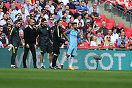 Pep Guardiola, the Manchester city manager (2nd left) looks on as Sergio Aguero of Manchester city holds his back as he prepares to go back onto the field after receiving treatment for a knock. The Emirates FA Cup semi-final match, Arsenal v Manchester city at Wembley Stadium in London on Sunday 23rd April 2017.<br /> pic by Andrew Orchard,  Andrew Orchard sports photography.