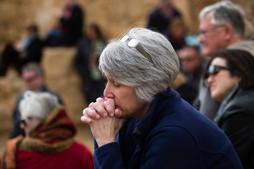 An American Evangelical Christian tourist, part of a group led by Former Arkansas governor Mike Huckabee (not pictured) prays during a visit to the ancient hilltop fortress of Masada in the Judean desert in Israel, on February 19, 2015. The ancient ruined desert fortress on a wind-swept plateau overlooking the Dead Sea is seen by many as an emblem of Israel's fighting spirit, it is believed to be the place where close to a thousand Jewish rebels killed themselves and each other about two millennia ago, rather than surrender and fall into slavery under the Romans.