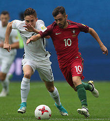 June 24, 2017 - Saint Petersburg, Russia - Ryan Thomas (L) of the New Zealand national football team and Bernardo Silva of the Portugal national football team vie for the ball during the 2017 FIFA Confederations Cup match, first stage - Group A between New Zealand and Portugal at Saint Petersburg Stadium on June 24, 2017 in St. Petersburg, Russia. (Credit Image: © Igor Russak/NurPhoto via ZUMA Press)
