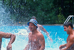Men in a swimming pool splashing around