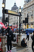 People some of them wearing face protective masks, walk in the rain near Oxford Circus in central London on Thursday, Aug 5, 2021. Met Office forecasts 26 hours of heavy rain and thunderstorms to batter the British capital. (VX Photo/ Vudi Xhymshiti)