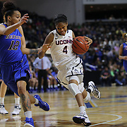 Moriah Jefferson, UConn, drives past Brittany Hrynko, DePaul, during the UConn Vs DePaul, NCAA Women's College basketball game at Webster Bank Arena, Bridgeport, Connecticut, USA. 19th December 2014