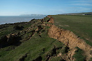 Coastal soil erosion on the south side of the Isle of Wight, United Kingdom. This eroded landscape is fast approaching the coast road which links the east of the island with the west. There is currently no provision or plan to sure up the area or move the road.(photo by Mike Kemp/In Pictures via Getty Images)