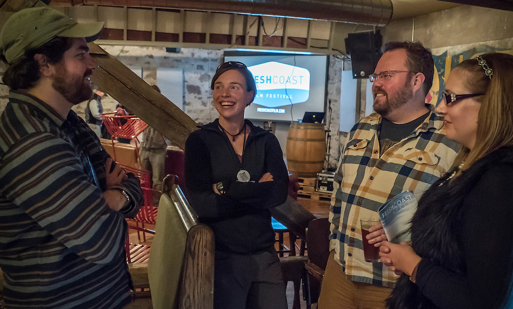 Filmmaker Nate Ptacek, left, and explorer Amy Freeman, center, chat with festival goers during the Fresh Coast Film Festival in Marquette, Michigan. The festival, held annually in October, celebrates the outdoor lifestyle and environment of the Great Lakes region.