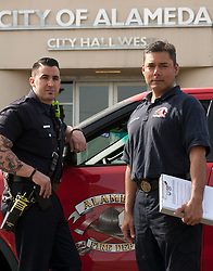City of Alameda, Calif. firefighter paramedics Patrick Corder, left, and Armando Baldizan pose for a photograph at their office on Alameda Point, Wednesday, April 5, 2017, in Alameda, Calif. (Photo by D. Ross Cameron)