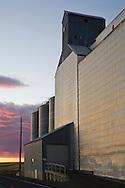 grain elevator and road at sunset in palousse washington