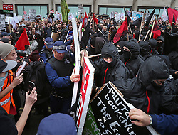 © Licensed to London News Pictures. 04/11/2015. London, UK. Police clash briefly with students outside the Department for Innovation and Skills as a demonstration takes place in central London over tuition fees and cuts. Photo credit: Peter Macdiarmid/LNP