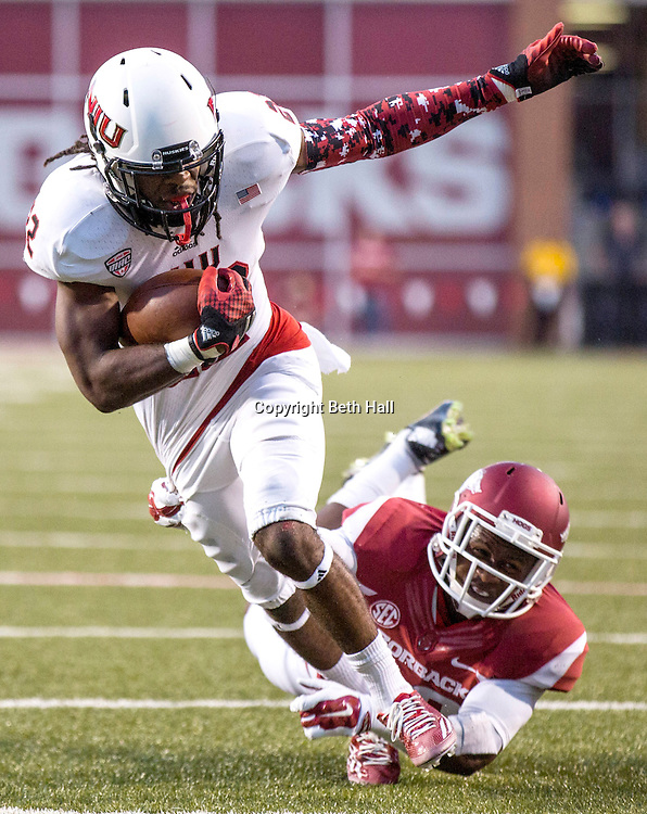 Sep 20, 2014; Fayetteville, AR, USA; Northern Illinois University Huskies wide receiver Aregeros Turner (22) gets past Arkansas Razorbacks tailback Joel Bouagnon (28) to score a touchdown during the first half of a game at Donald W. Reynolds Razorback Stadium. Mandatory Credit: Beth Hall-USA TODAY Sports