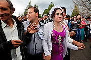 The kalajdzii dance during hours the ring dance. Teenagers dance wiht parents and grandparents. Each spring in Mogila, Bulgaria, is celebrated the Gypsy Bride Market. In this festival the virginity is for sale. The honor can be bought. Every girl has a price to be agreed between the parents of the girl and the candidate. The price can range between 1.500 and 10.000€, in a country where the minimum salary is just over 100€. The market joins the Kalajdzii families, known as the thracians tinkerers, whose tradition is still alive. Many girls dress as real princesses, others prefer to dress in a modern way. They dance during hours the ring dance while grandparents and parents watch the way the young interrelate. Many girls dream to be married by the rite imposed by the tradition. Nowadays there are some girls that don't agree with the tradition and would prefer not to marry, although they assist to these market all the times. Divorces and elopements, so far taboo, are becoming everytime more frequent. Beyond the topic, ethnologists, define it as the Kalajdzii's disco, where the family honor is involved in a commercial transaction. This ritual has being celebrated for years, so anthropologists think is not going to change too much in future.