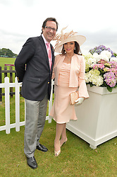 DAME JOAN COLLINS and PERCY GIBSON at the Cartier Queen's Cup Polo final at Guard's Polo Club, Smiths Lawn, Windsor Great Park, Egham, Surrey on 14th June 2015