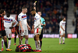 Stoke City's Eric Maxim Choupo-Moting (right) is given a yellow card by Referee Paul Tierney during the Premier League match at the Vitality Stadium, Bournemouth.