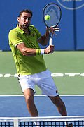 MARIN CILIC hits a volley at the Rock Creek Tennis Center.