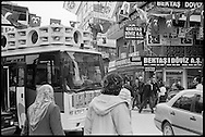 Loud party buses blare music and slogans in the streets of Istanbul during election campaigning.