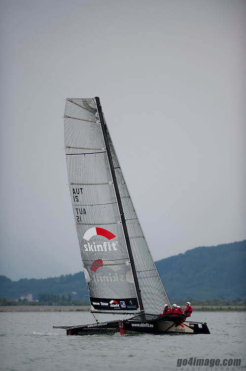 2011 June 17, Lindau Germany RUND UM,  a race with lot of rain, the winer is the Swiss Multihull Holy Smoke of Andreas Schiesser, build 1989. M2 Skinfit from Fritz Tripolt Yacht Club Bregenz finishing third