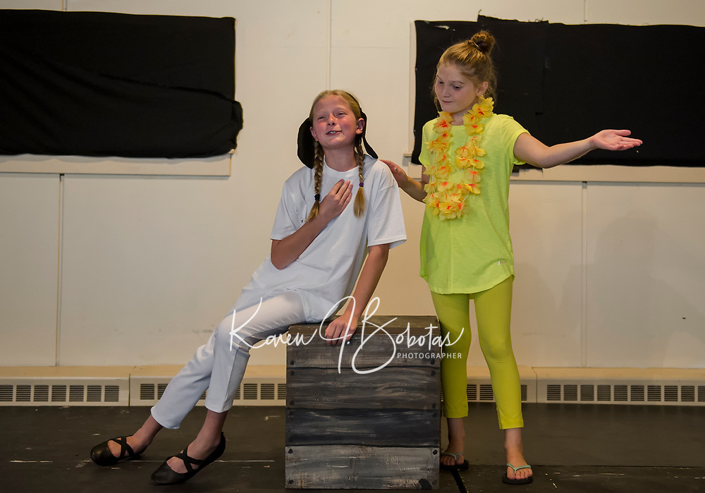 """Isabella Cottrell """"Snoopy"""" and Abby Wernig """"Woodstock"""" during dress rehearsal for """"You're A Good Man, Charlie Brown"""" with SKYT - Streetcar Kids and Youth Theater Sunday evening at Gilford Methodist Church.  (Karen Bobotas/for the Laconia Daily Sun)"""